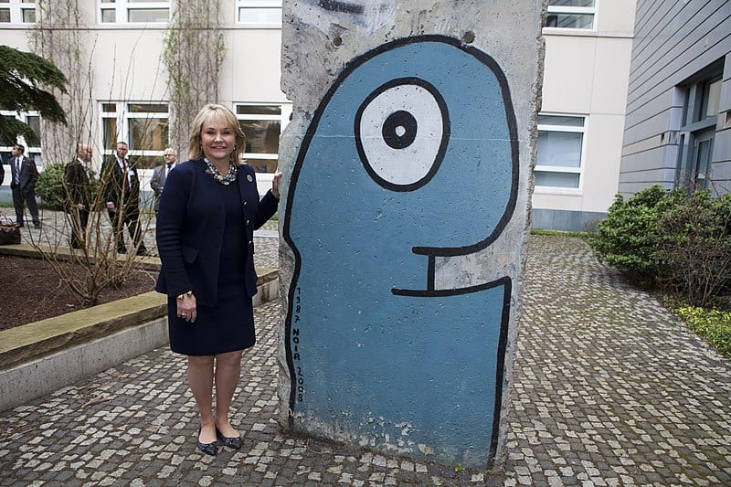Governor Mary Fallin with a work by Thierry Noir, painted on a piece of the Berlin Wall